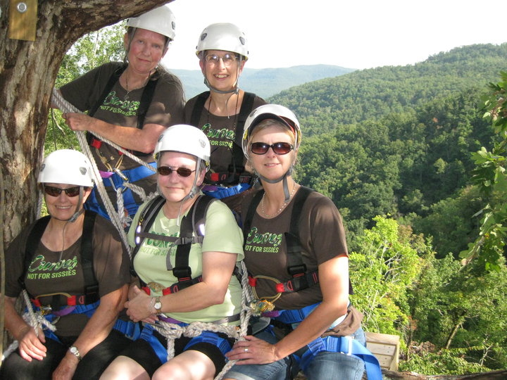 A group of beautiful gal pals give us a smile on the zip line.
