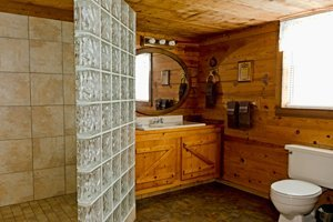 The cabin features a spacious bathroom with walk-in shower