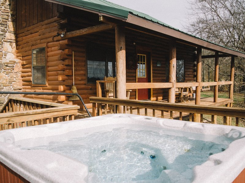 Enjoy a soak in the cabin's outdoor hot tub.