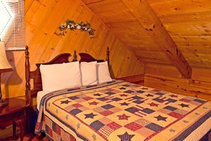 The cabin's loft features two queen beds.