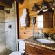 The cabin features a roomy tile shower and vanity area.