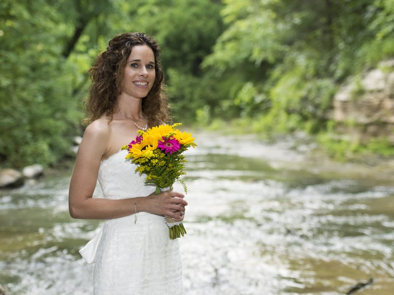 Cedar Crest Lodge and its lovely creekside setting is the perfect place for an Arkansas wedding.