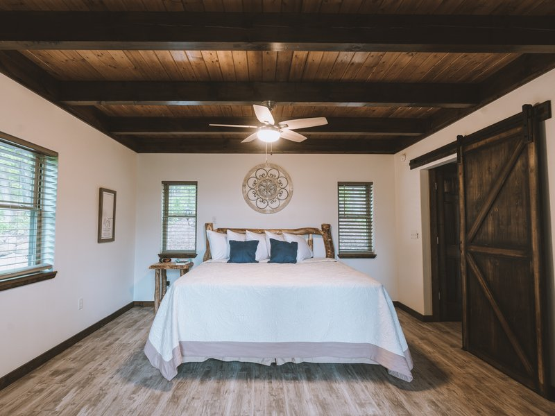 The Foxfire Cabin's private bedroom with king size bed.
