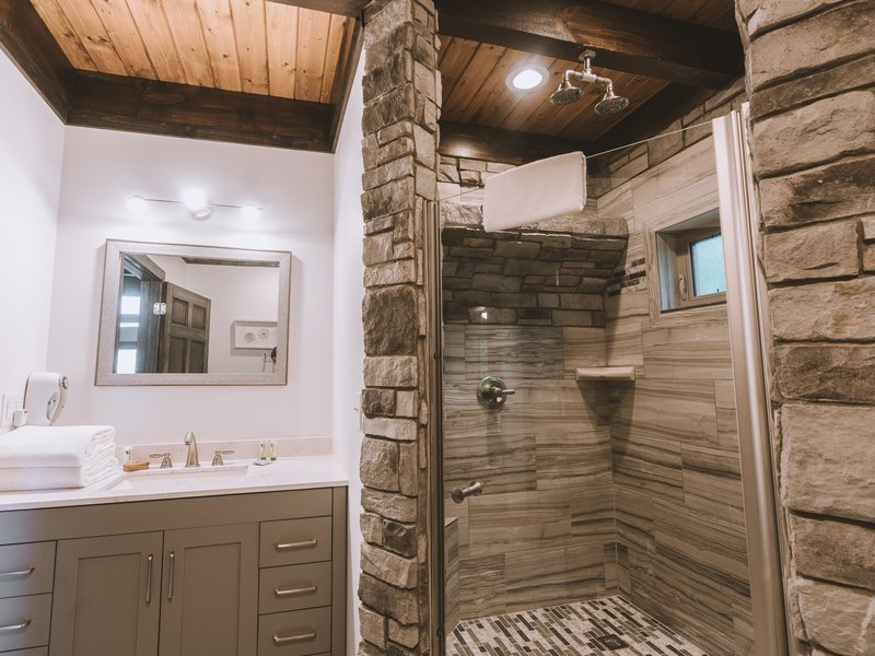 The Foxfire Cabin's bathroom with waterfall shower.