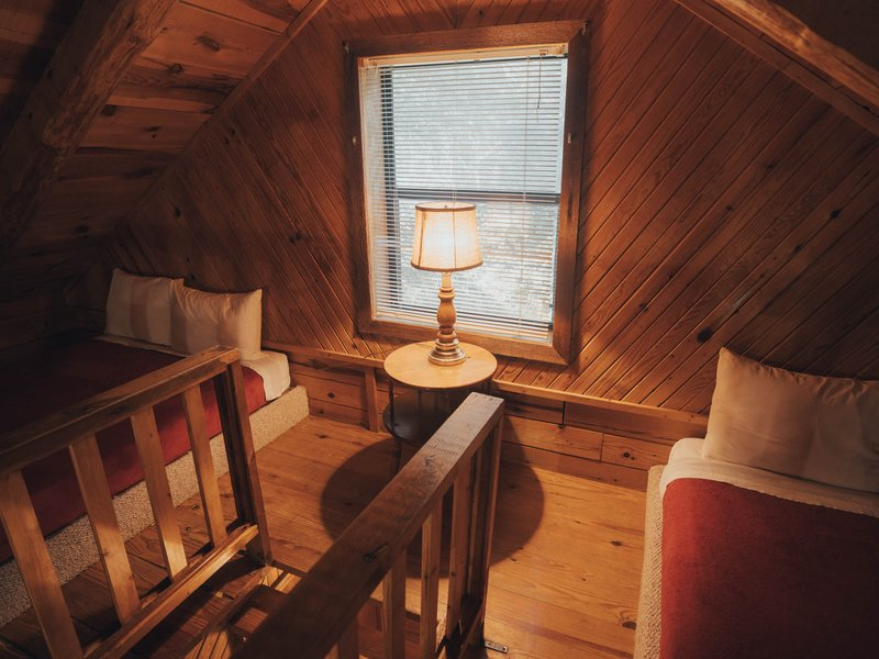 The cabin's loft has two full-size beds