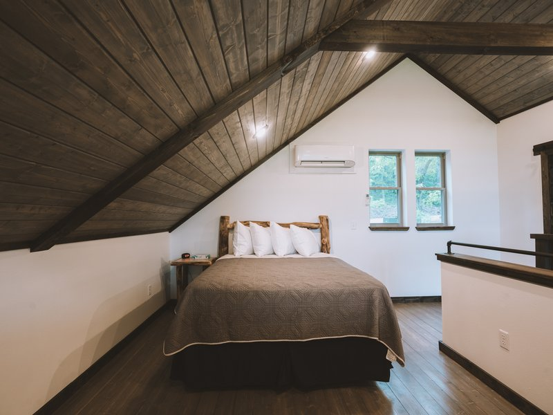 The Foxfire Cabin's loft features a queen size bed.