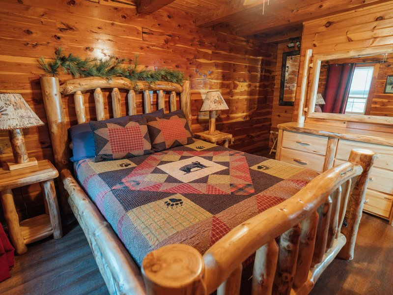 The Waterfall Cabin's master bedroom with queen bed.