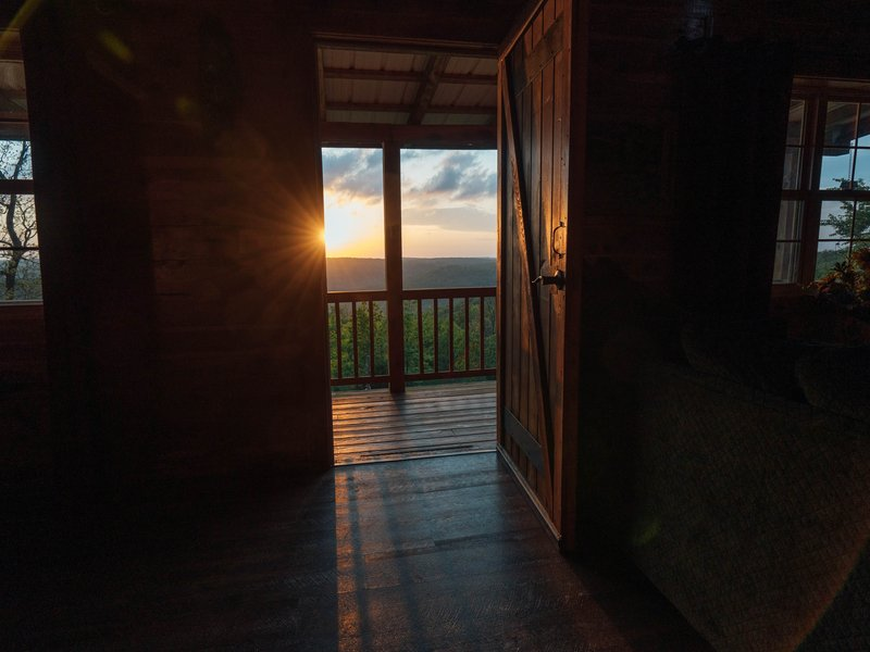 Sunset view through the front door of the Waterfall Cabin