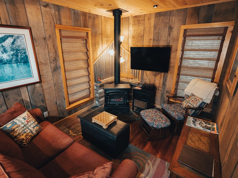 The cozy living room of the Creekside Cabin
