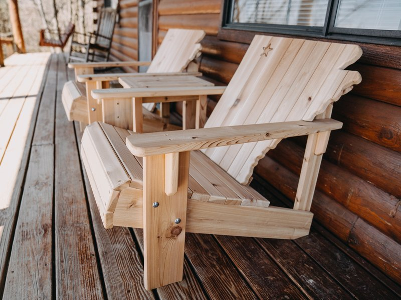 Arkansas Chairs on the porch of the Arkansas Cabin