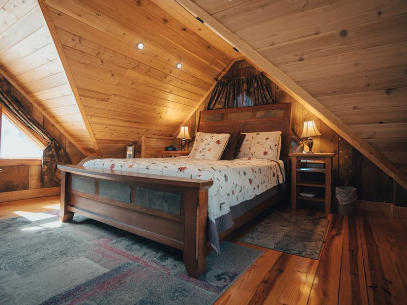 The beautiful bedroom loft of the Creekside Cabin.