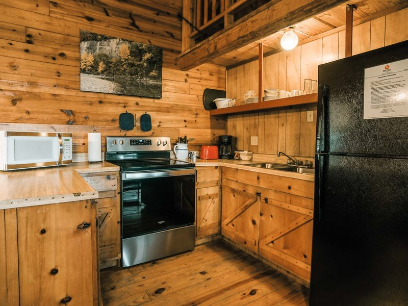 A view of the cabin's fully furnished kitchen
