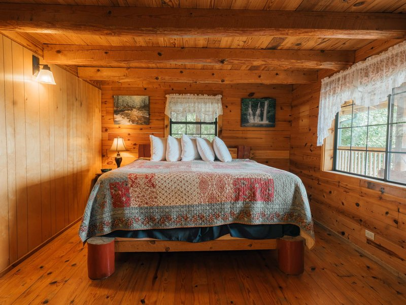 King bed, located on the cabin's main floor (open floor plan)