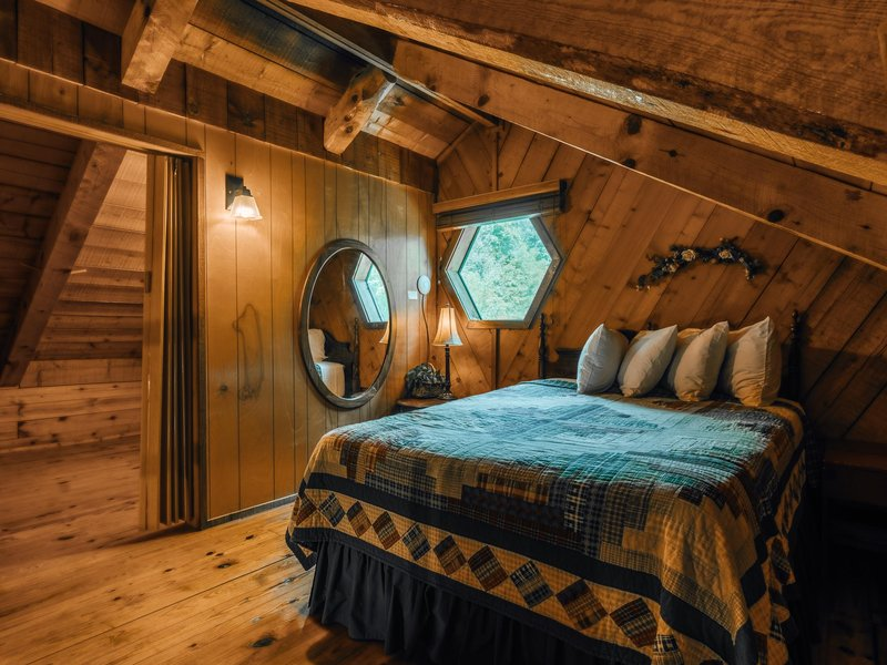 The cabin's loft features one queen size bed.