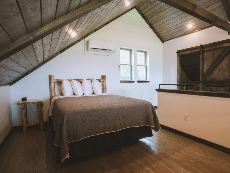 The Morning Glory Cabin's loft with queen size bed.