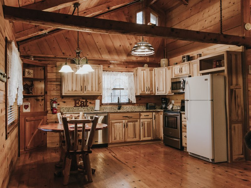 The cabin's kitchen is fully furnished, including dishes, pots/pans, utensils, silverware and more.