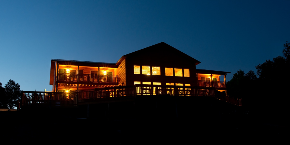 RiverWind Lodge glows at night over Buffalo River country