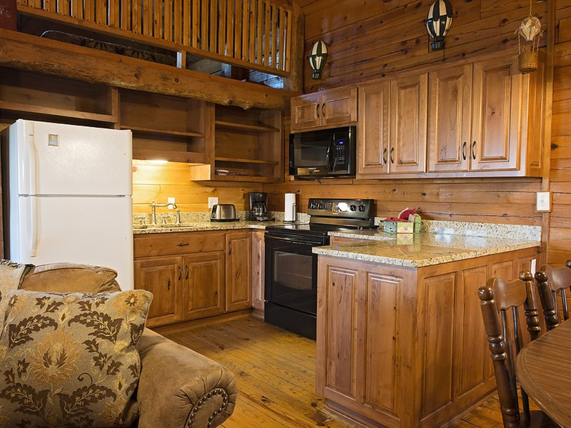 The cabin features a furnished kitchen and lots of counterspace.