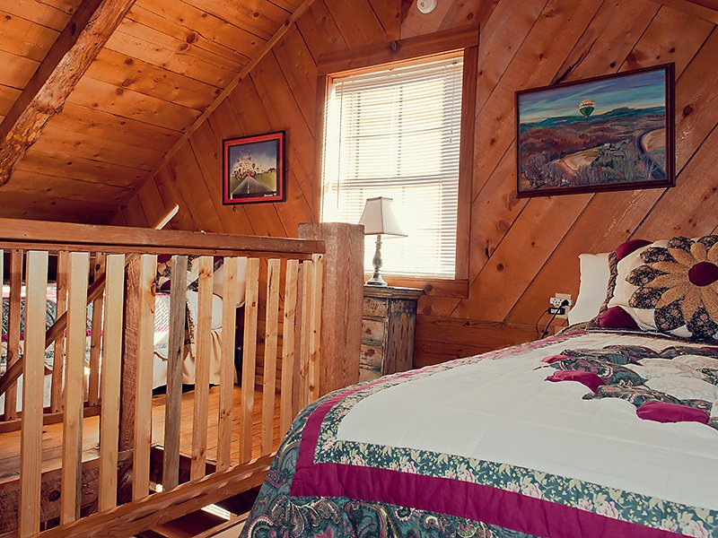 The Balloon Cabin's loft features two queen beds