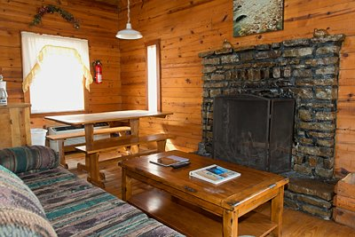 The cozy fireplace of Cabin 1