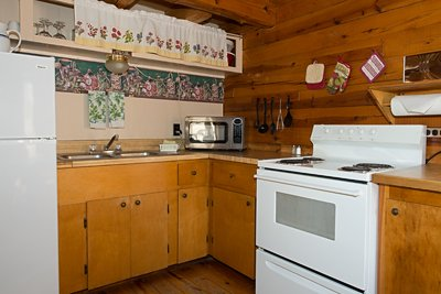 The fully furnished kitchen of Cabin 1