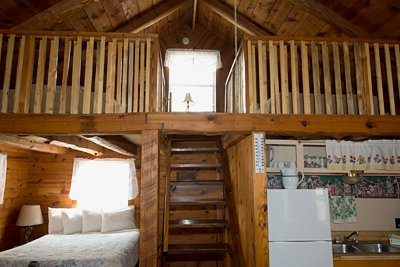 The loft with two full-size beds and downstairs queen bed in Cabin 1