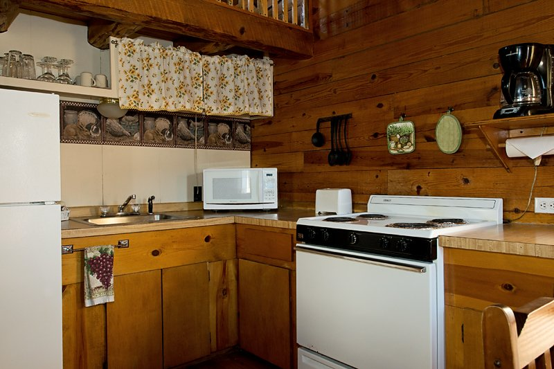 The tidy, fully-furnished kitchen in Cabin 2
