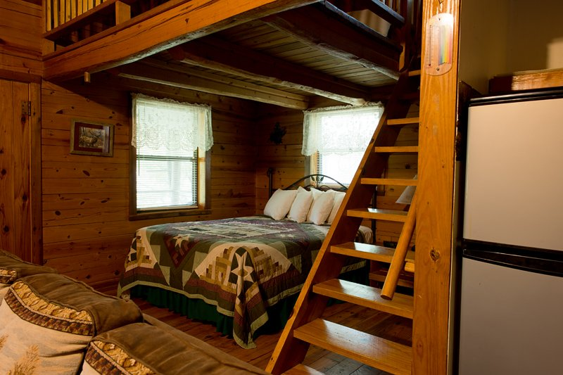 A queen bed is on the main floor with 2 full-size beds in the loft.