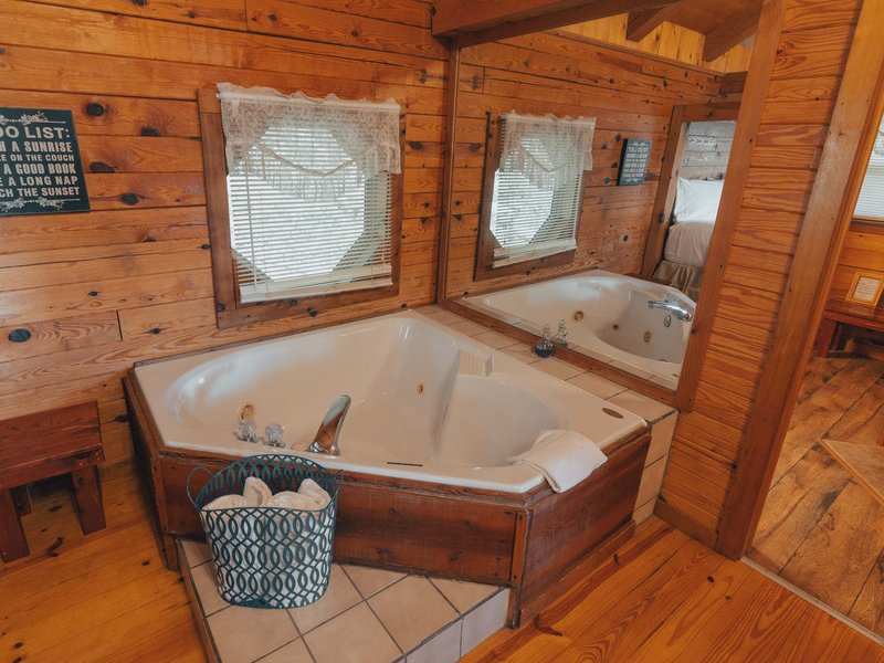 A bedside Jacuzzi tub adds a cozy romantic touch to the cabin's interior.