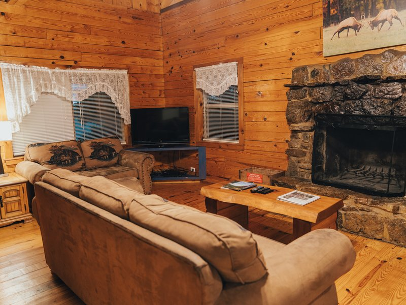 The fireplace and living area in the Mountain Magic Cabin