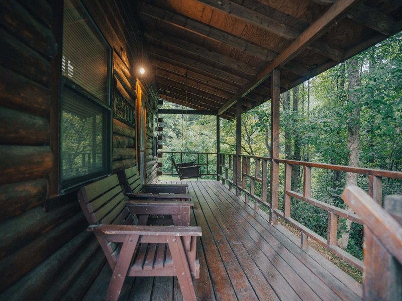 The quiet, peaceful porch of the Songbird Cabin.