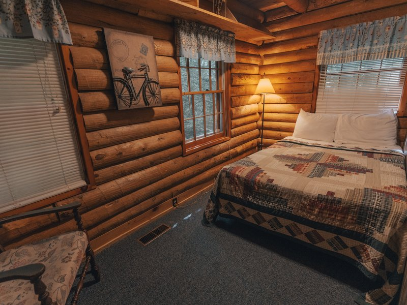A full-size bed sleeping area is located on the main floor.