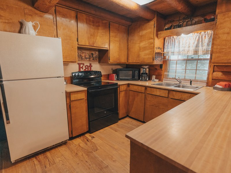 The kitchen in the Mills Cabin is roomy and has a large food prep counter.