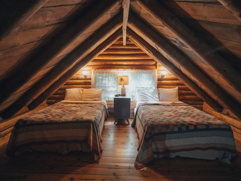 The roomy loft of the Mills Cabin features 2 full-size beds.
