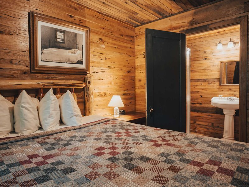 The main bedroom, which gives access to the cabin's shower bath.