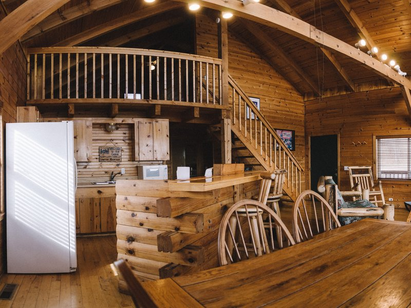 View of the cabin's dining and kitchen areas.