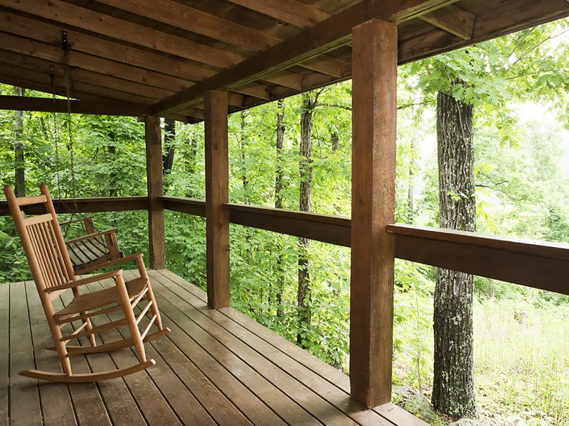 Watch the sunrise from the peace and quiet of the cabin's front porch.