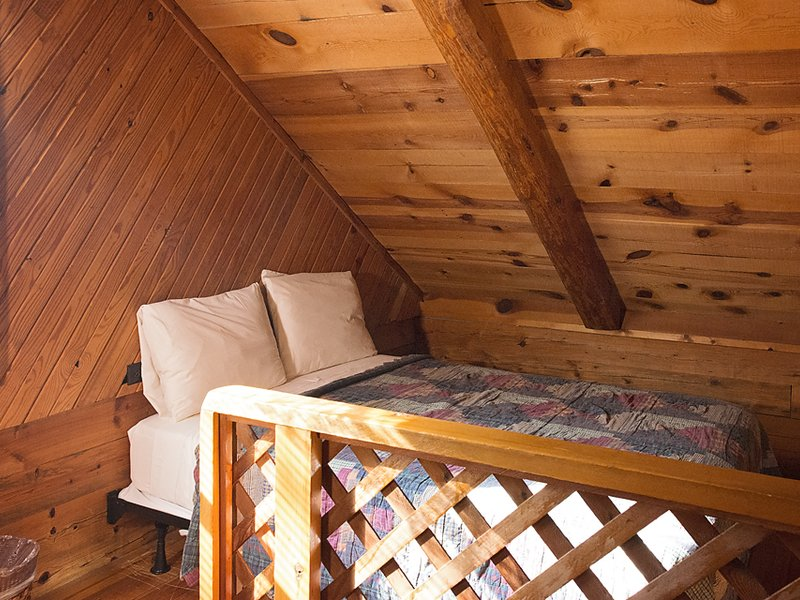 The Songbird Cabin's loft features two full-size beds. (only 1 shown in photo)