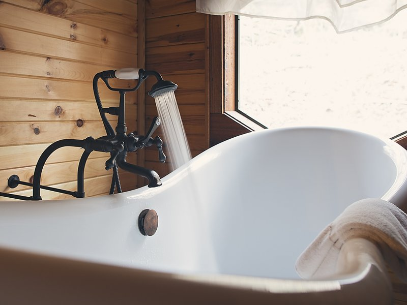 The cabin's soaking tub is the perfect spot to relax after a day of outdoor adventure.