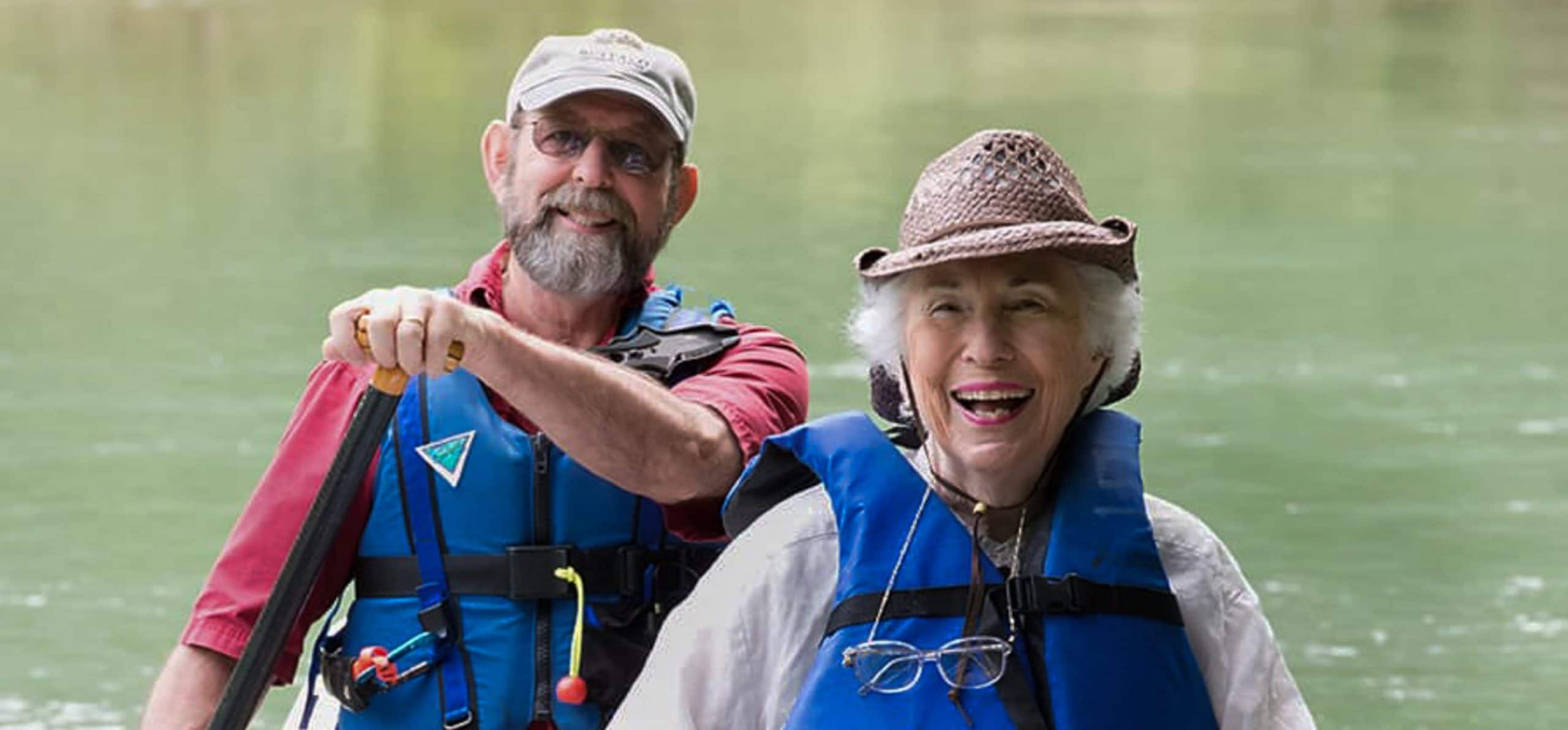 two adults canoeing