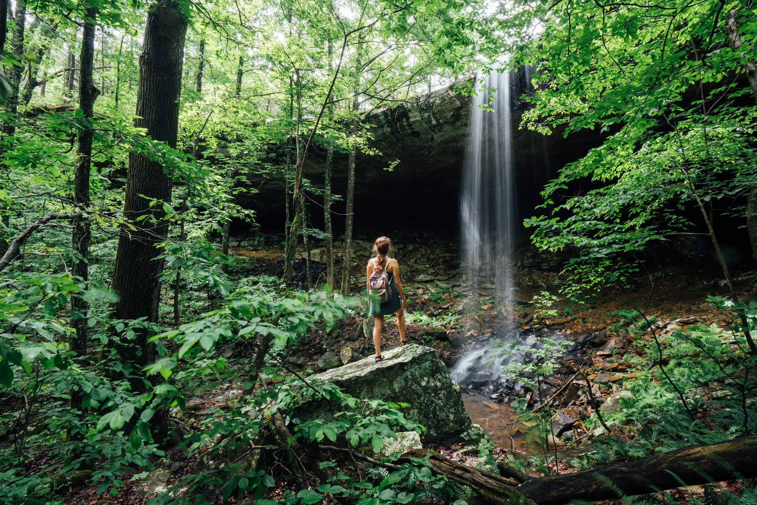 hiker in front of Hideout Hollow Falls