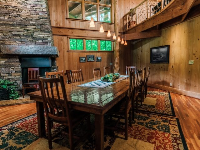 A 14-person, custom-built table graces the lodge's formal dining area