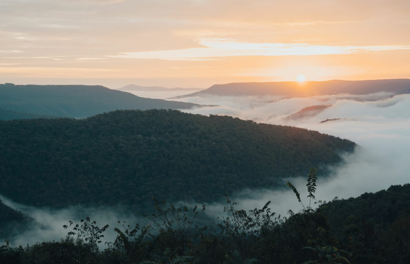 sunrise and misty mountain tops
