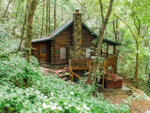 The Mills Cabin offers guests a secluded location and outdoor hot tub deck.