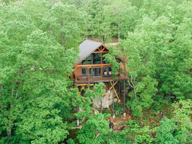 Catch the sunrise from the treetop setting of the Foxfire Cabin.