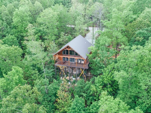 The Wanderlust Cabin in its secluded treetop setting.