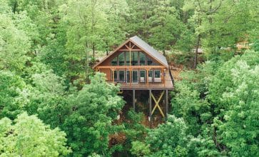 Surround yourself with the treetops of Buffalo River country in the Wildwood Cabin,.