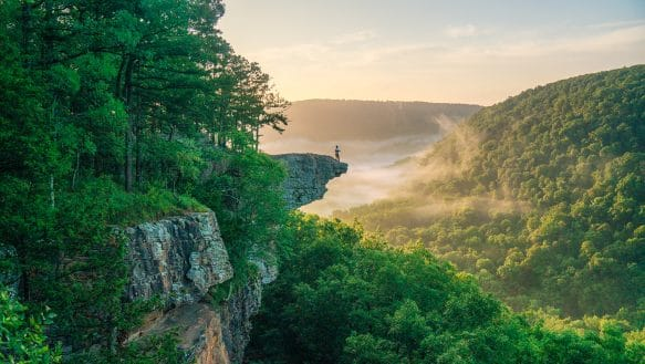 Sunrise and hiker at Whitaker Point