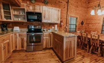 The spacious fully-appointed kitchen of the Windridge Cabin makes group meal prep a snap!