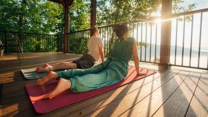 Couple doing yoga at BOC Cabin